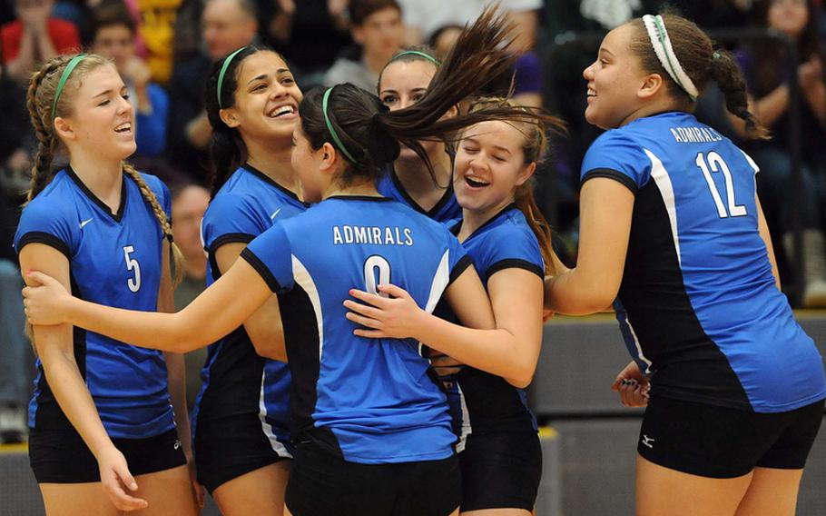 The Rota Admirals celebrate their third straight Division III title after defeating Sigonella 25-18, 25-23, 25-19 at the DODDS-Europe volleyball championships at Ramstein, Saturday.