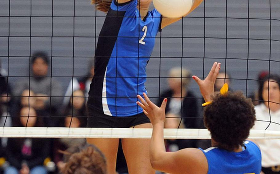 Rota's Aspen Luna slams a ball back across the net for a point in front of Sigonella's Allison Cruz, left, and Sydney Moore in the Division III final at the DODDS-Europe volleyball championships. Rota took its third straight Division III title with a  25-18, 25-23, 25-19 win.