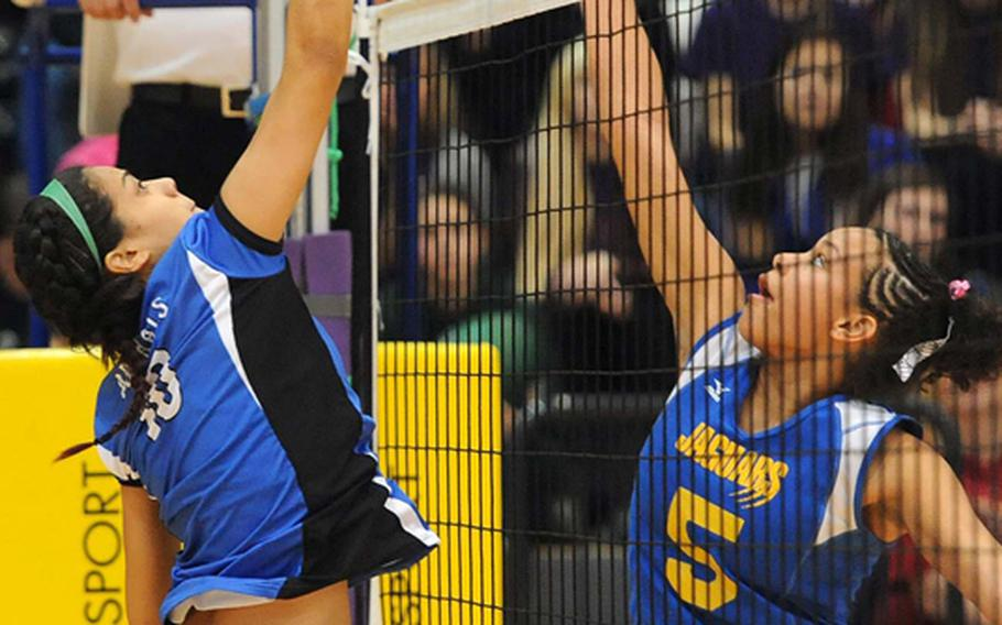 Rota's Natalia Rivera, left, and Sigonella's Deeanna Brown battle at the net in the Division III final at the DODDS-Europe volleyball championships. Rota took its third straight Division III title with a  25-18, 25-23, 25-19 win.