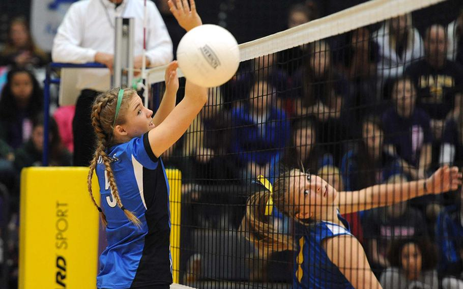 Sigonella's Rachel Vosler, right, watches her ball get past Rota's Tiffani Driscoll in the Division III final at the DODDS-Europe volleyball championships. Rota took its third straight Division III title with a  25-18, 25-23, 25-19 win.