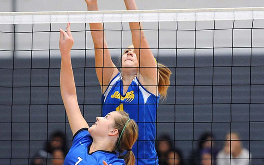 Rota's Hailey Landry, foreground, attempts to get the ball over Sigonella's Rachel Vosler in the Division III final at the DODDS-Europe volleyball championships. Rota took its third straight Division III title with a  25-18, 25-23, 25-19 win.