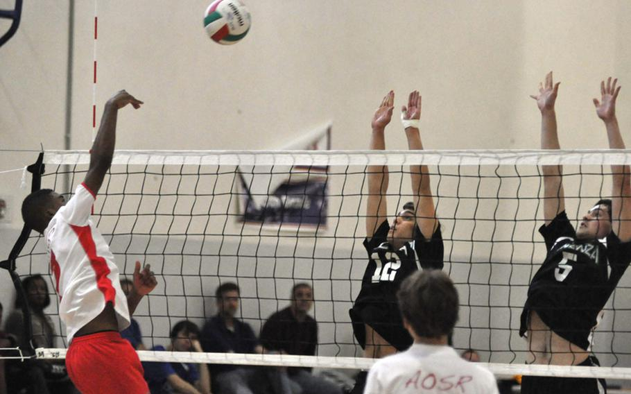 American Overseas School of Rome's Justin Tuimavana tries to get the ball past the Vicenza duo of Nicolo Novek, left, and Anthony Guerra during pool play Saturday morning at the 2012 Mediterranean Volleyball Championships at Aviano Air Base, Italy.