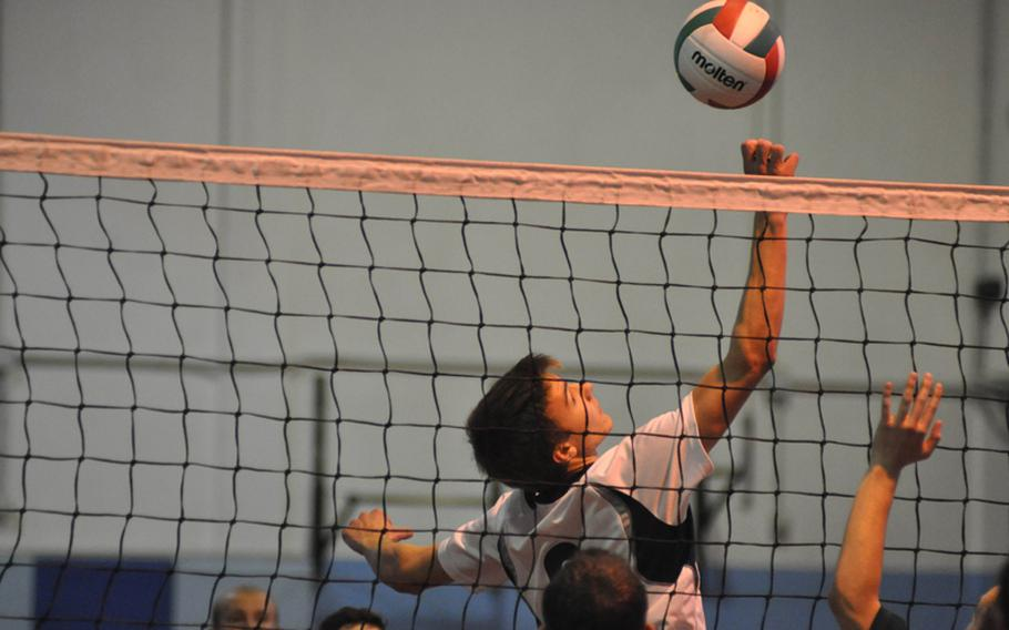 Aviano's Matthew O'Brien dinks the ball over the net Saturday in pool play at the 2012 Mediterranean Volleyball Championships. The Saints fell to Ankara 16-25, 29-27, 15-9.