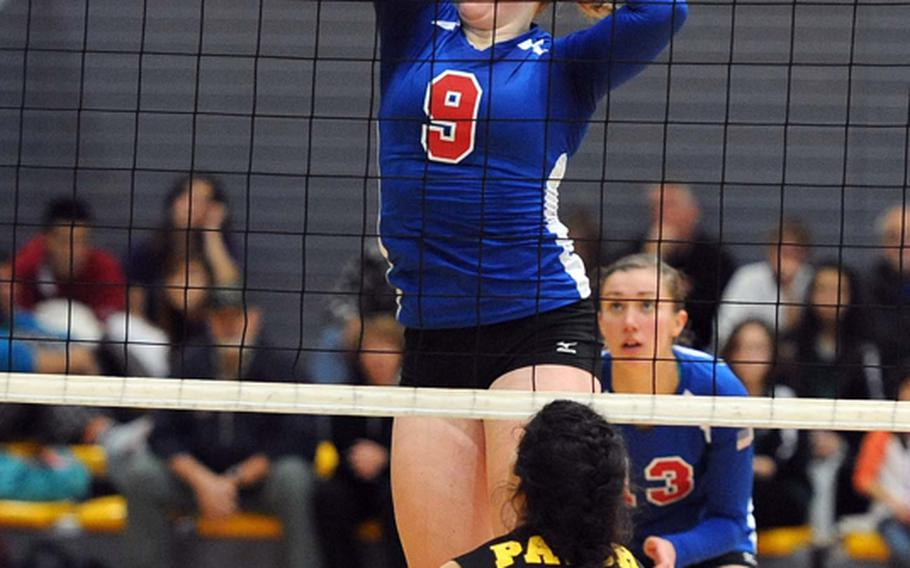 Ramstein's Sarah Schiller knocks the ball over the net against Patch's Stephanie Trujillo in the Division I final at the DODDS-Europe volleyball championships in Ramstein, Saturday. The Royals beat Patch 25-12, 25-14, 25-19 to defend their title.
