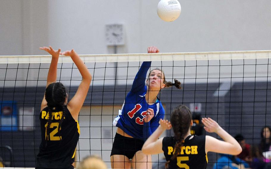 Ramstein's Sarah Szybist slams the ball past Patch's Mercedes Deets, left, and Adrianna Callahan in the the Division I final at the DODDS-Europe volleyball championships in Ramstein, Saturday. The Royals beat Patch 25-12, 25-14, 25-19 to defend their title.
