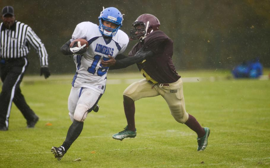 Rota's Ramon Quijano is pushed out of bounds by Baumholder's Laquell Coleman in the first half of play in the 2012 DODDS-Europe Division III football championship Saturday afternoon in Baumholder, Germany.