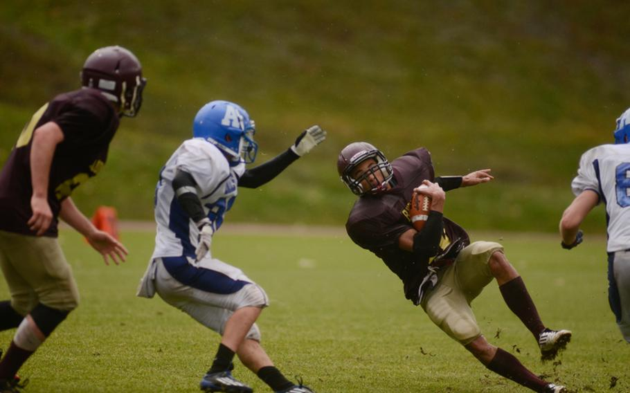 Baumholder's Ben McDaniels loses his footing in the Buccaneers' 26-0 win over the Rota Admirals in the wet 2012 DODDS-Europe Division III football championship Saturday afternoon in Baumholder, Germany.