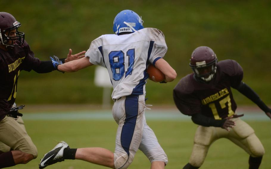 Rota's Brooks Furleigh tries to get past Baumholder's Ben McDaniels after intercepting a pass Saturday afternoon in the 2012 DODDS-Europe Division III football championship in Baumholder, Germany.