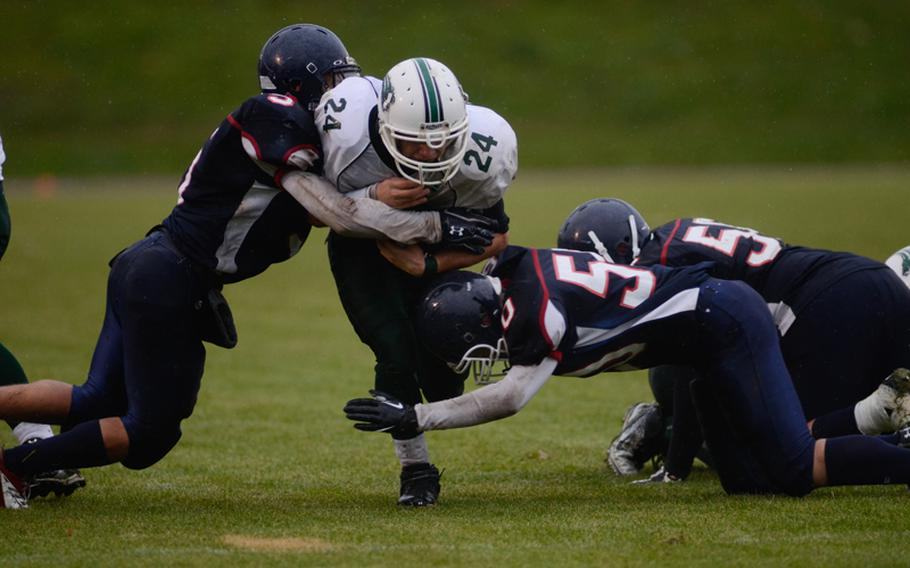Naples' Tyler Williams is taken down by several Bitburg Barons Saturday evening in the 2012 DODDS-Europe Division II football championships in Baumholder, Germany.