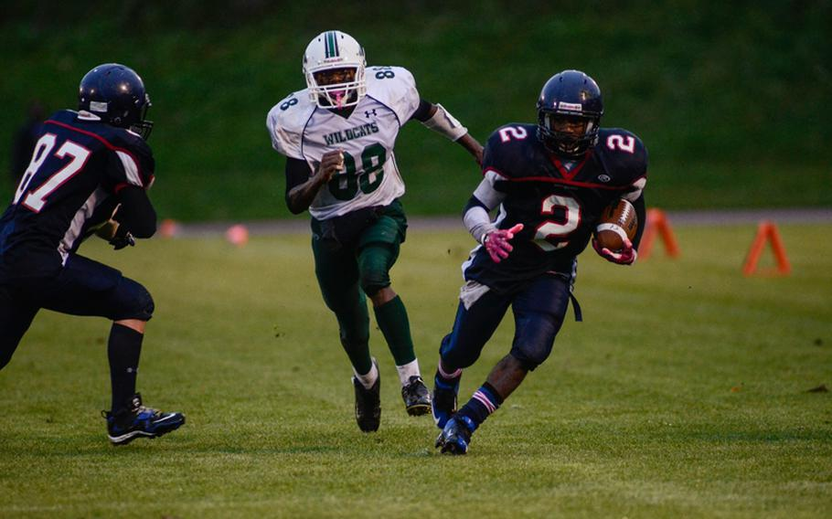 Bitgurg's CJ Evans picks up a first down Saturday evening in the 2012 DODDS-Europe Division II football championship in Baumholder, Germany. Bitburg edged Naples 22-20 to win its record fourth championship in a row.