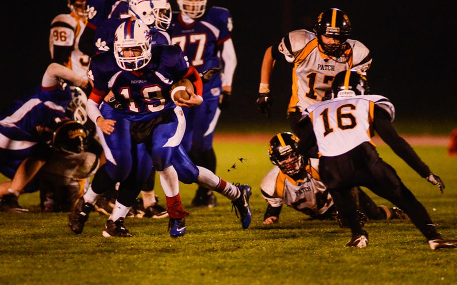 Ramstein's Lucas Mireles cuts back to get by Patch's Jake Williams Saturday night in the Division I DODDS-Europe football championship in Baumholder, Germany. Ramstein beat Patch 26-7.