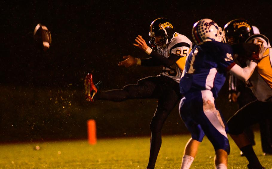Patch's Hunter Massey punts the ball Saturday night in the Division I DODDS-Europe football championship in Baumholder, Germany. Ramstein beat Patch 26-7.