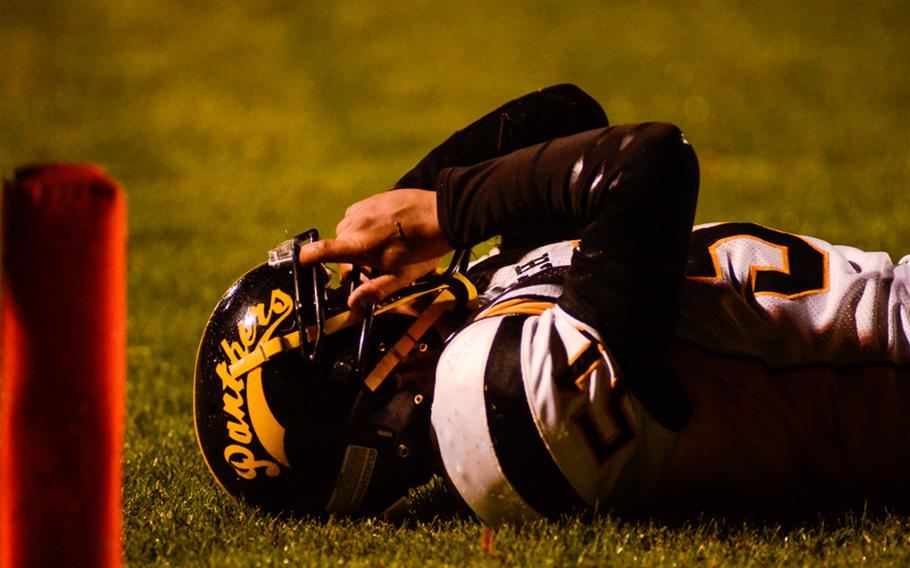 Patch's Jonathan Velasquez lies on the field after narrowly missing a tackle Saturday night in the Division I DODDS-Europe football championship in Baumholder, Germany. Ramstein beat Patch 26-7.