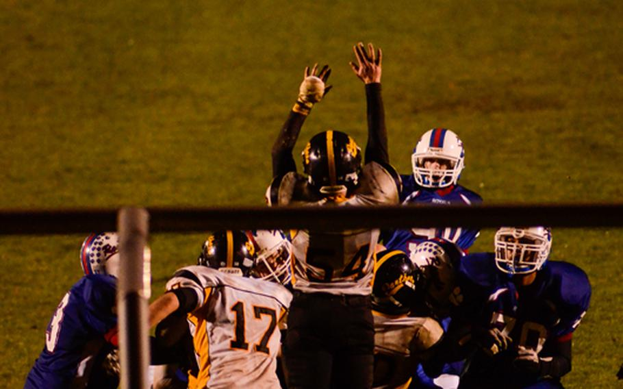 Ramstein's Cody Collins kicks in an extra point Saturday night in the Division I DODDS-Europe football championship against Patch in Baumholder, Germany. Ramstein beat Patch 26-7.