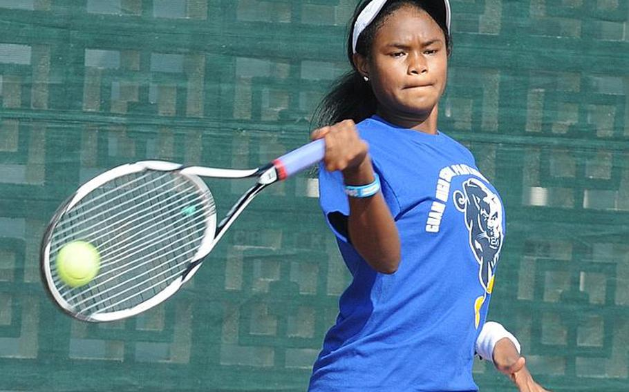 Guam High's Chloe Gadsden delivers a forehand against Kadena's Erika Youngdahl during Thursday's girls singles championship in the Far East High School Tennis Tournament at Kadena Air Base, Okinawa. Gadsden repeated her singles title of a year ago, beating Youngdahl 6-0, 6-2.