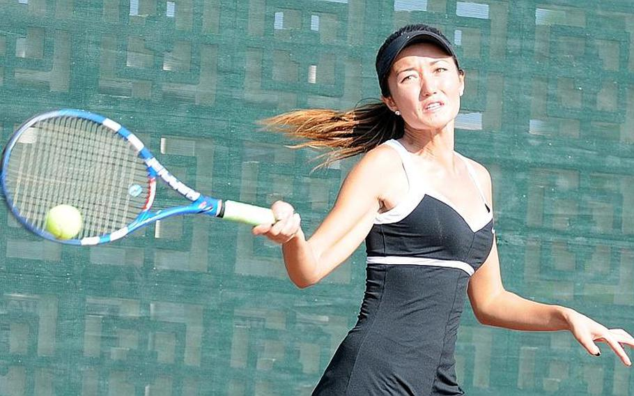 Kadena'sErika Youngdahl rips a forehand against Guam High's Chloe Gadsden during Thursday's girls singles championship tie in the Far East High School Tennis Tournament at Kadena Air Base, Okinawa. Gadsden repeated her singles title of a year ago, beating Youngdahl 6-0, 6-2.