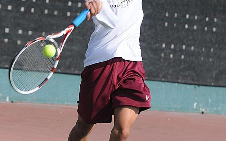 Matthew C. Perry's Sam Cadavos hits a net-approach forehand against Seoul American 's Andrew Clark during Thursday's boys third-place match in the Far East High School Tennis Tournament at Kadena Air Base, Okinawa. Cadavos won 8-2.