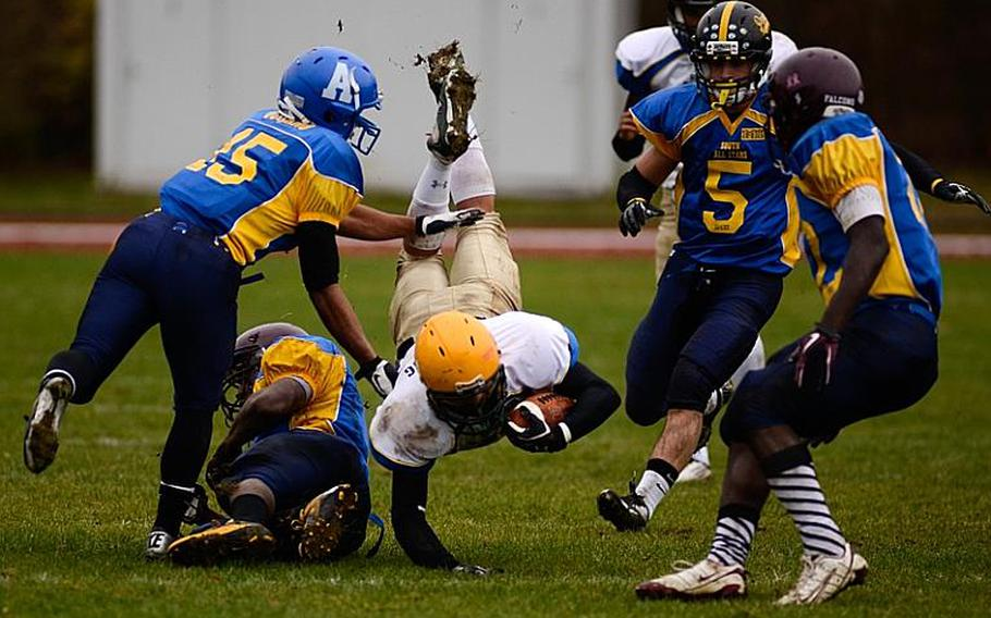 DODDS-Europe North All-Star football team member  Connor Manning of SHAPE High School is taken down by a swarm of South All-Star defenders Saturday afternoon in Vilseck, Germany as the South All-Stars defeated the North 29-10.