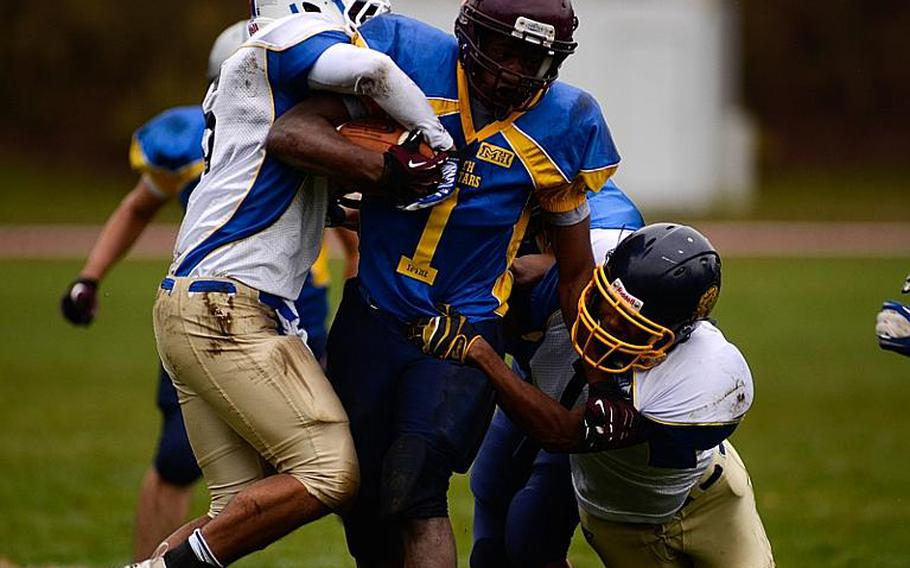 DODDS-Europe South All-Star football team member  Carlton Campbell of Vilseck High School drags a couple of North All-Star team defenders downfield Saturday afternoon in Vilseck, Germany as the South All-Stars defeated the North 29-10.