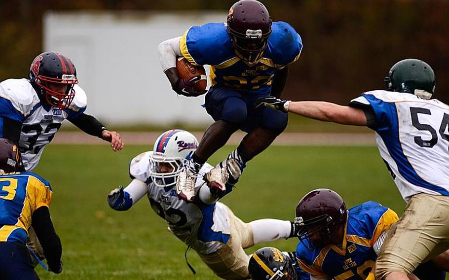 DODDS-Europe South All-Star football team member  Shawn Peebles of Vilseck High School takes to the air in a short gain Saturday afternoon in Vilseck, Germany as the South All-Stars defeated the North 29-10.