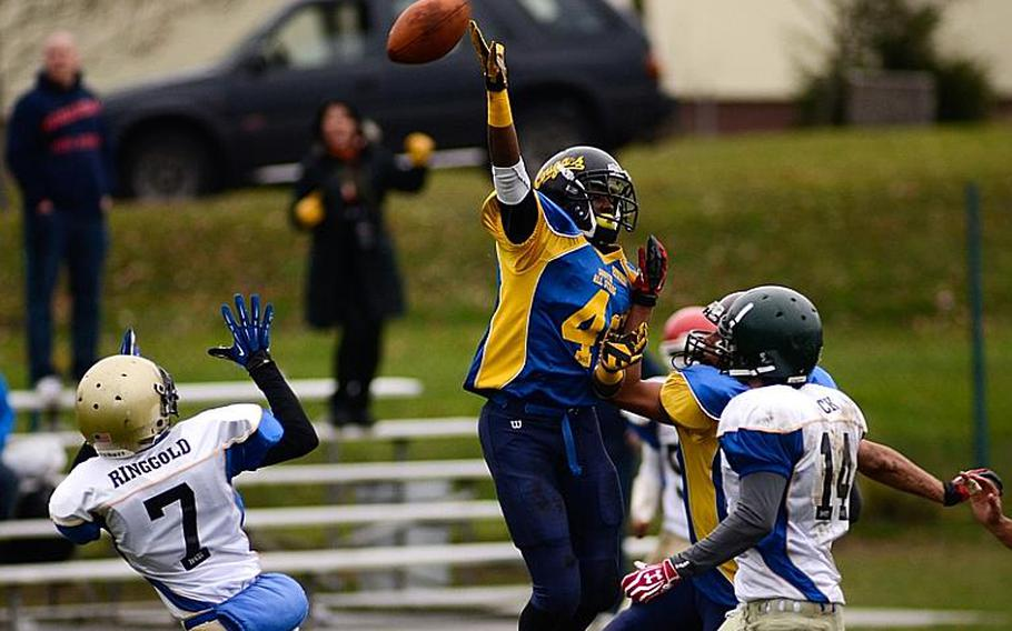 DODDS-Europe North All-Star football team member  Dennis Ringgold, far left, of Wiesbaden High School moves into position to catch a tipped pass Saturday afternoon in Vilseck, Germany as the South All-Stars defeated the North 29-10.