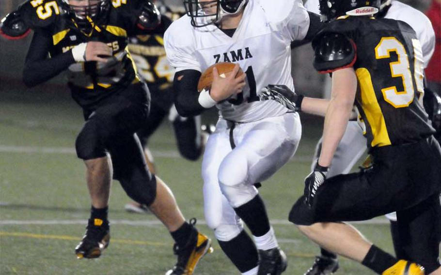 Zama American ball carrier Andre Encarnacion, shown running at American School In Japan, has been named Stars and Stripes' Pacific high school football Player of the Year.