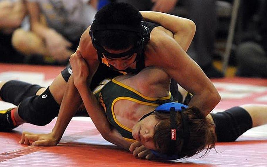Kadena's Justin Duenas gains the advantage on Robert D. Edgren's Francis Estacion during last year's 101-pound gold-medal bout in the 35th Far East High School Wrestling Tournament. Duenas returns at 108/115 pounds for the Panthers this season.