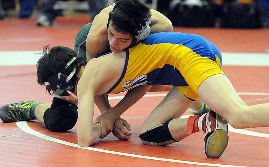 Kubasaki's Steven Walter gets the upper hand on St. Mary's International's Kaimi Miyazawa during last year's 108-pound gold-medal bout in the 35th Far East High School Wrestling Tournament. Walter is back in Kubasaki's lineup, seeking a three-peat, and will wrestle at 115 pounds.