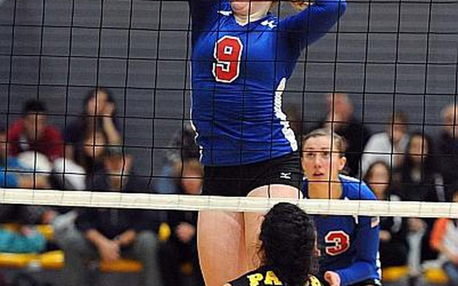 Ramstein's Sarah Schiller knocks the ball over the net against Patch's Stephanie Trujillo in the the Division I final at the DODDS-Europe volleyball championships in Ramstein last year. Schiller will be returning for the Royals when the 2013 season gets under way this weekend.