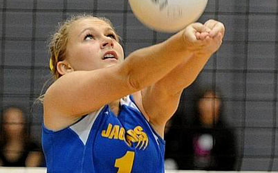 Sigonella's Rachel Vosler returns a ball in last year's Division III finals in Ramstein Vosler will be returning for the Jaguars this season.