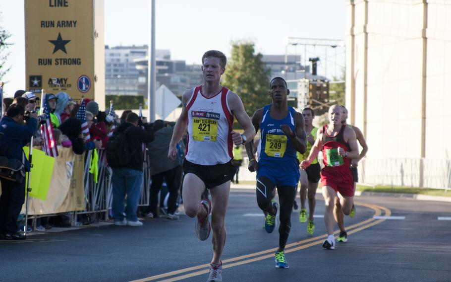 Runners cross the finish line of the 29th annual Army 10-Miler race outside the Pentagon on Oct. 20, 2013.