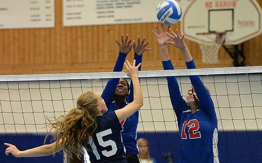 Lakenheath's Kristen Reed gets the ball over the Ramstein defense of Denee Lawrence and Chera Jensen in a match at Ramstein, Saturday, Oct. 12, 2013. The DODDS-Europe volleyball championships get under way at Ramstein and Kaiserslautern on Thursday, Oct. 31.