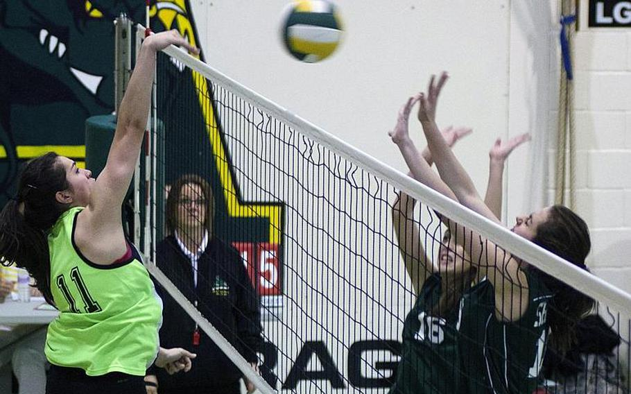 Leila Hall, Alconbury junior, hits the ball against SHAPE during a game at RAF Alconbury, England, Saturday, Oct. 5, 2013.The DODDS-Europe volleyball championships get under way at Ramstein and Kaiserslautern on Thursday, Oct. 31.
