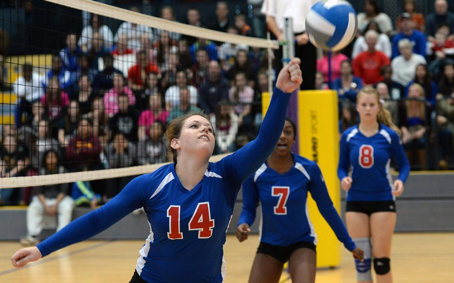 Ramstein's Jenna Kirchhoefer keeps the ball inbounds as teammates Denee Lawrence, center, and Karlijn Van Gaalen watch. Ramstein defeated Lakenheath 25-18, 25-20, 25-19 in the Division I final at the DODDS-Europe volleyball Championships in Ramstein, Germany, Nov. 2, 2013.