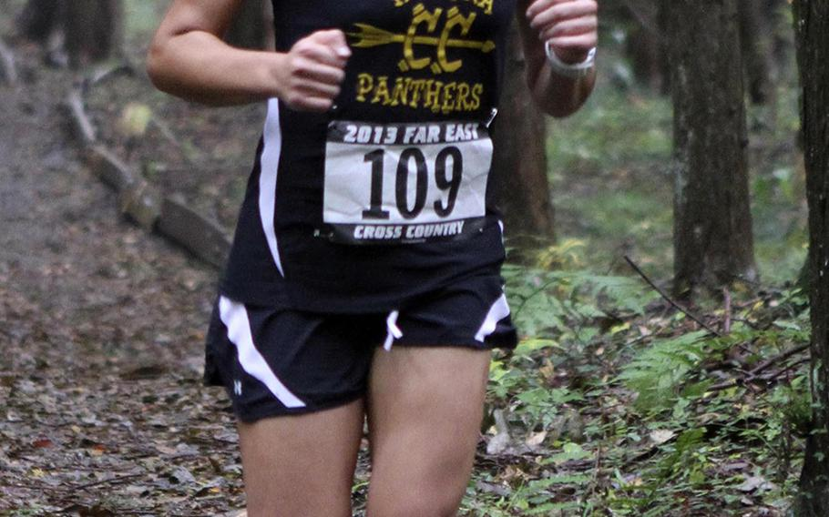 Kadena's Ana Hernandez navigates the wooded part of the course during Monday's 3.1-mile individual girls race in the Far East High School Cross-Country Meet at Camp Fuji, Japan. Hernandez repeated her girls championship, running 21 minutes, 9.4 seconds.