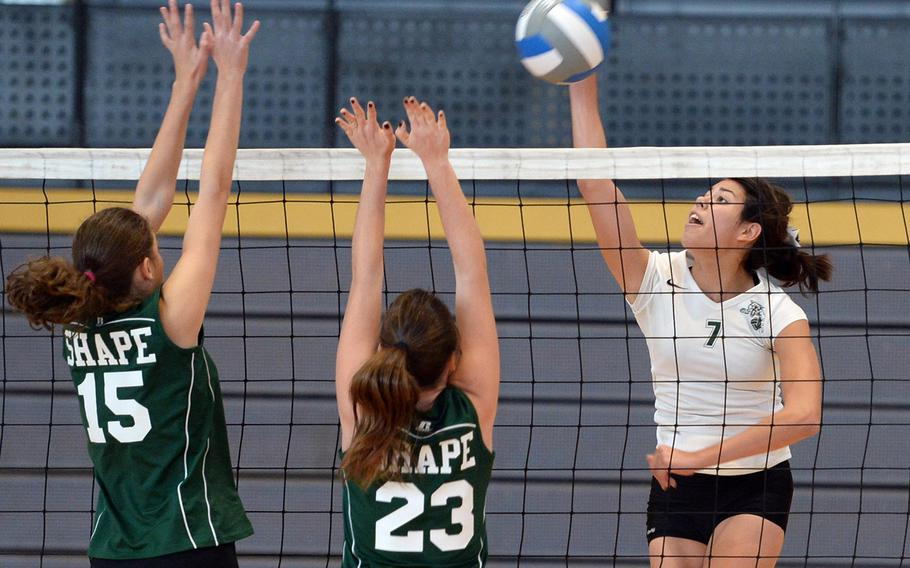Victoria Krause of Naples, right, hits against SHAPE's Begona Rodriguez Bravo, left, and Maria Arevalo Narvaez at the DODDS-Europe volleyball championships in Ramstein, Germany, Oct. 31, 2013. Krause has been named the Stars and Stripes volleyball Athlete of the Year.