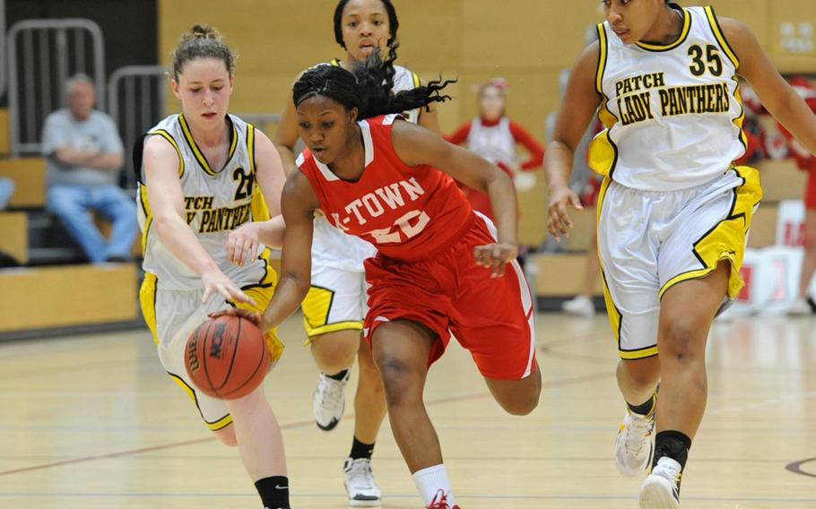 Kaiserslautern's Alana Dickerson drives the ball up the court against the Patch defense of Jenny Sparks,Treshon Jenkins and Breanna Rodriguez in a Division I semifinal at the DODDS-Europe Basketball Championships in Wiesbaden, Germany, in February. Dickerson will be returning for the Raiders this season as the team tries to defend the Division I title.