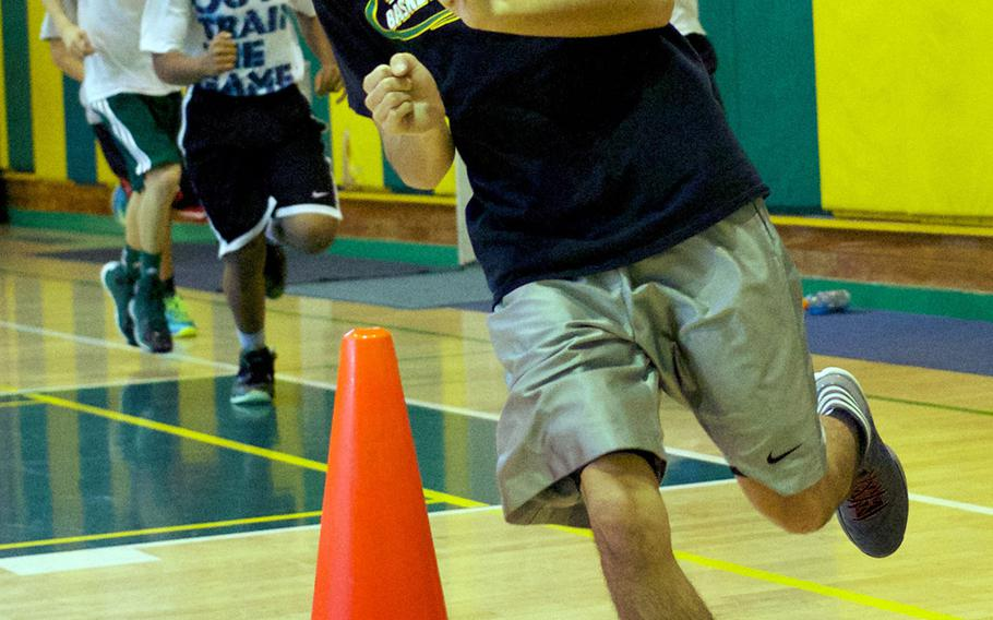 Senior guard Izzy Leon rounds a cone during Wednesday's Robert D. Edgren Eagles basketball practice.