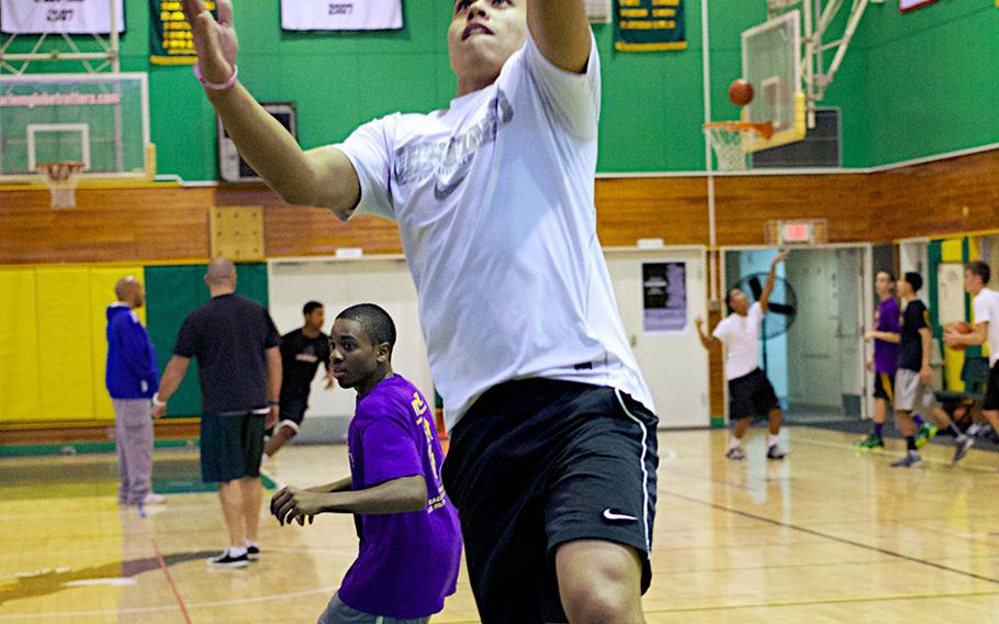Senior guard Tyrone Bacalso shoots a layup during Wednesday's Robert D. Edgren Eagles basketball practice.