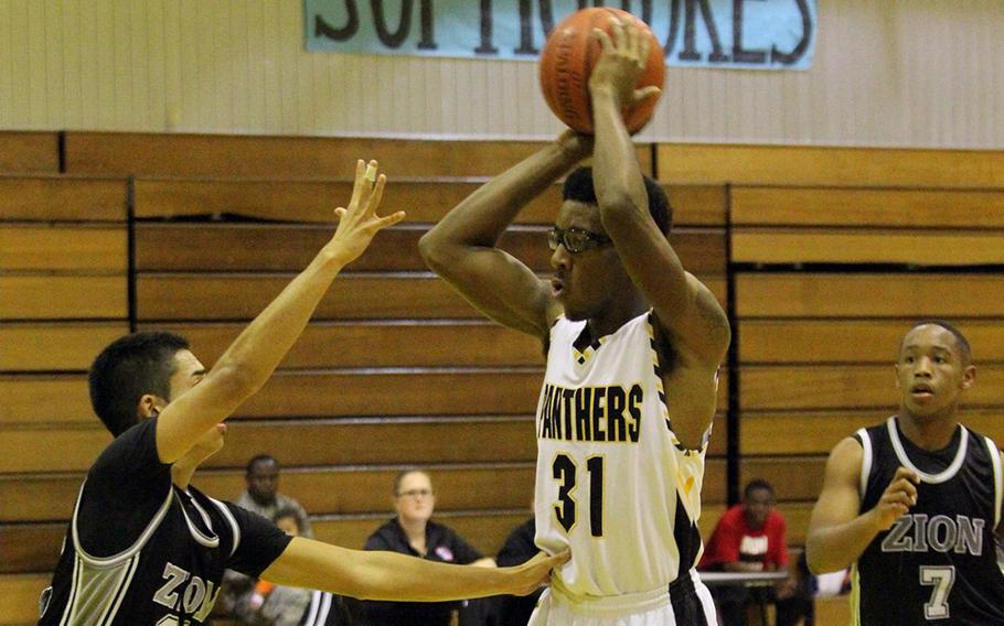 Senior Preston Harris of Kadena, with ball, was an all-Far East Division I Tournament selection last year for the Panthers.