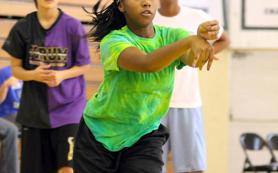 Kadena junior Desmon Reed dishes off a pass during Thursday's practice.