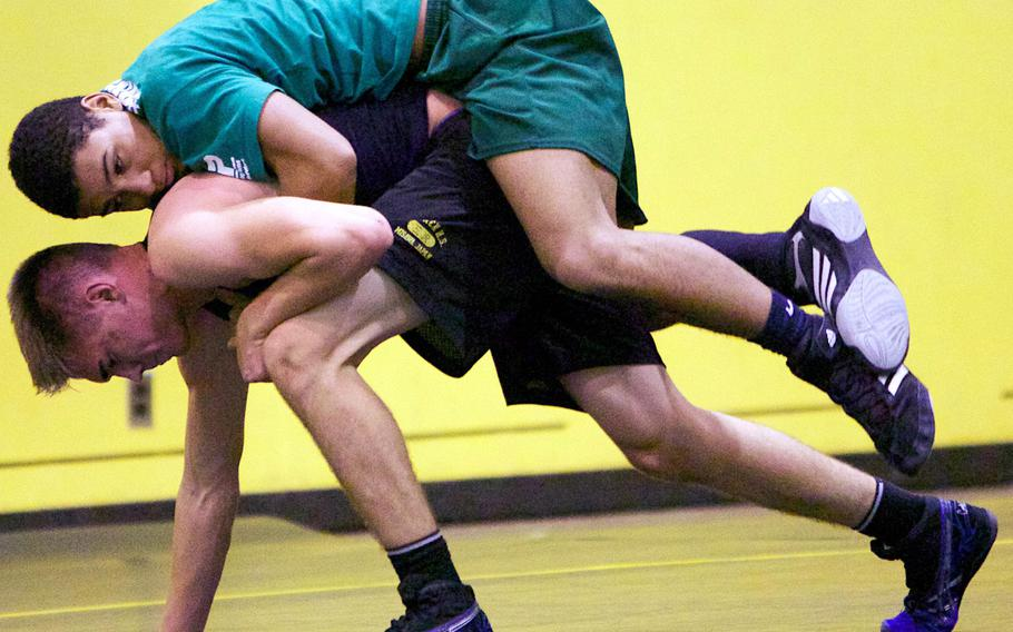 Robert D. Edgren senior Kaleb Atchison and sophomore Sky Phillips work out during practice on Wednesday.