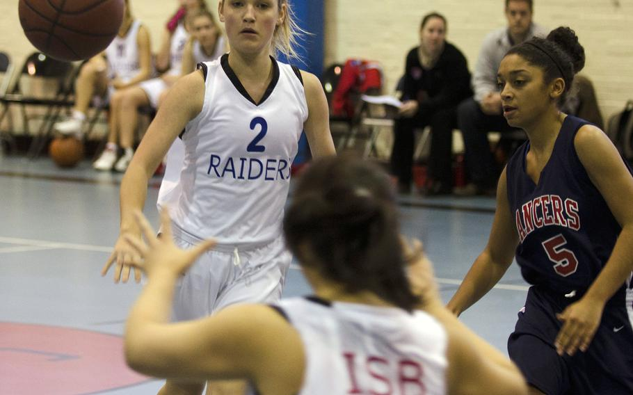 ISB player Kelsey Adamitis tosses a pass during a game against the Lakenheath Lancers on Saturday, Dec. 7, 2013, at RAF Lakenheath, England. The ISB girls lost to Lakenheath 37-15.