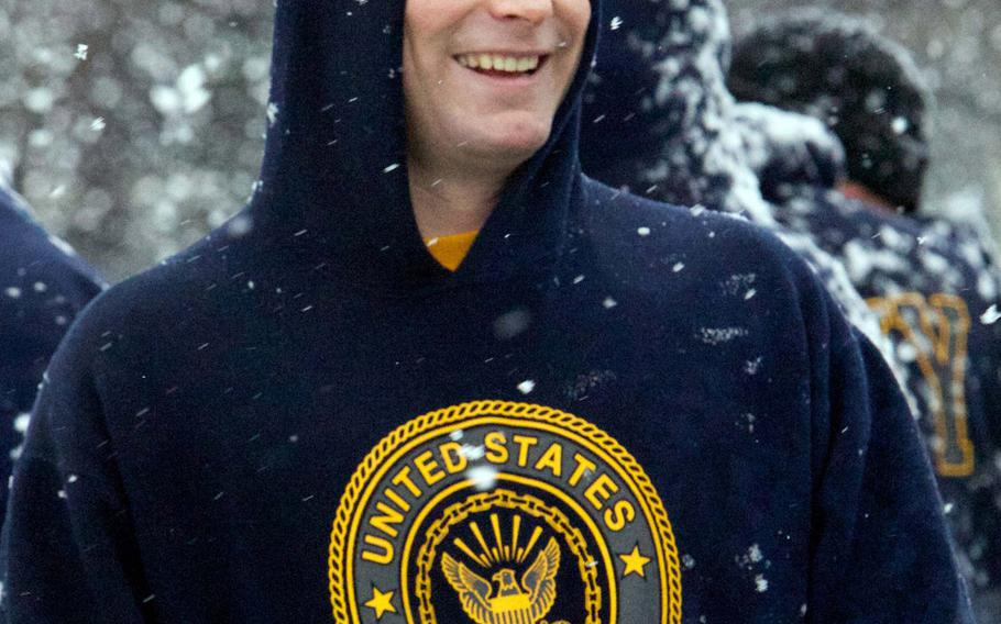 Navy Lt. Brian Allen manages a victory smile after Friday's Army-Navy flag-football rivalry game at  Misawa Air Base, Japan. Naval Air Facility Misawa beat the Army's 708th Military Intelligence Detachment 27-0 in a game played in wind-blown snow with temperatures around freezing.