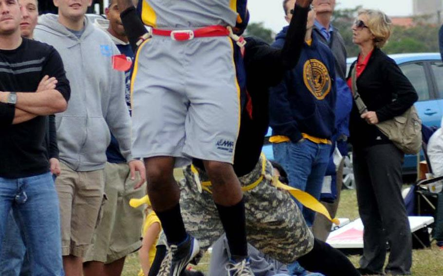 Navy receiver Damar Powell-Davis tries to get a handle on the ball during Saturday's 24th Army-Navy flag-football rivalry game at Torii Station, Okinawa. Army rallied to win 27-15.