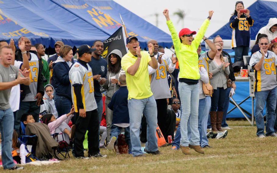 Navy fans cheer a touchdown during Saturday's 24th Army-Navy flag-football rivalry game at Torii Station, Okinawa. Army rallied to win 27-15.
