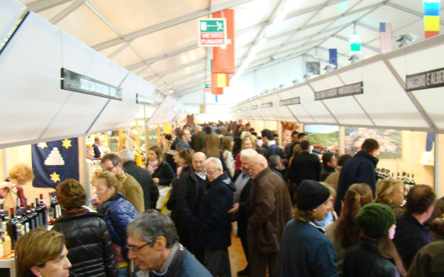 Truffles fans crowd a hall at the largest and most important of Europe's truffle festivals in Alba, Italy, in November 2013. Visitors from all over the world come to sample the exotic delicacy.