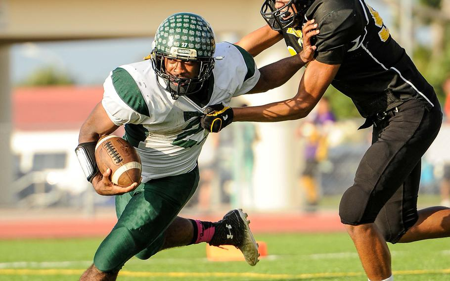 Kubasaki Dragons running back Tyshon Butler's 146 yards and a touchdown on 11 second-half carries were crucial to the Dragons' capturing the school's second Far East Division II football banner with a 34-31 overtime win over Kadena.