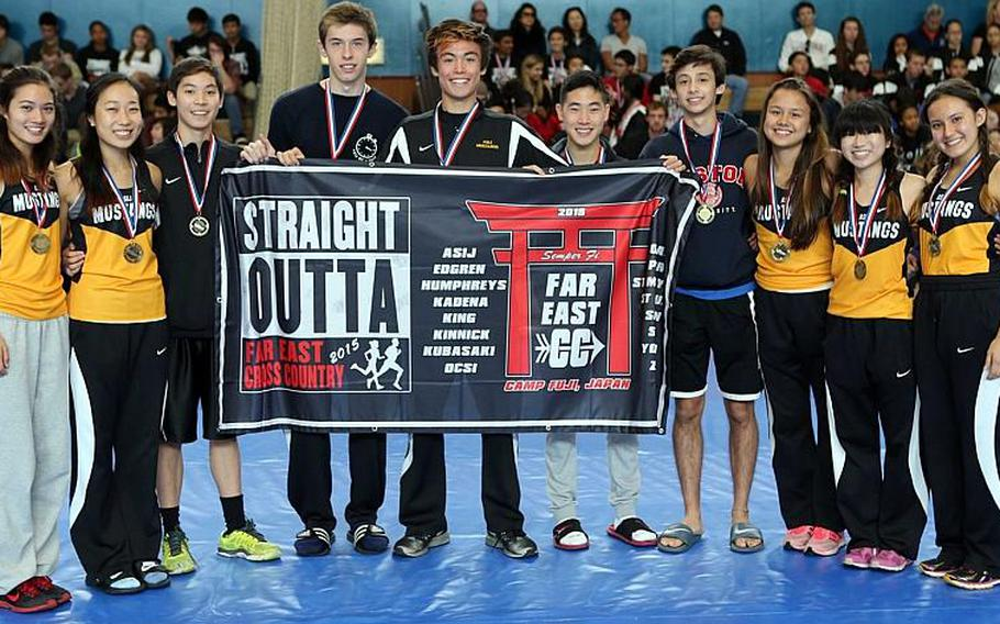 Back-to-back happiness for American School In Japan's cross country team, which repeated its Far East meet Division I overall school banner.