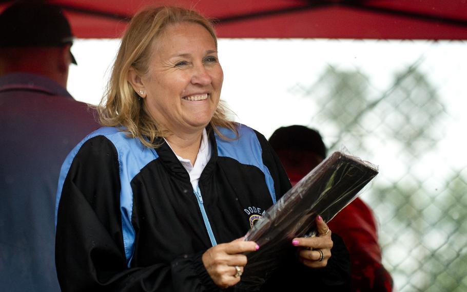 Karen Seadore, DODEA-Europe athletic director, hands out awards after the DODEA-Europe Division I baseball championship at Ramstein Air Base, Germany, on Saturday, May 28, 2016.